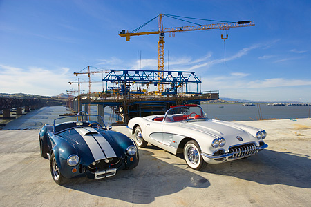 AUT 31 RK0069 01 © Kimball Stock 1966 Shelby Cobra 427 SC Replica Blue And White And 1960 Chevrolet Corvette White On Pavement