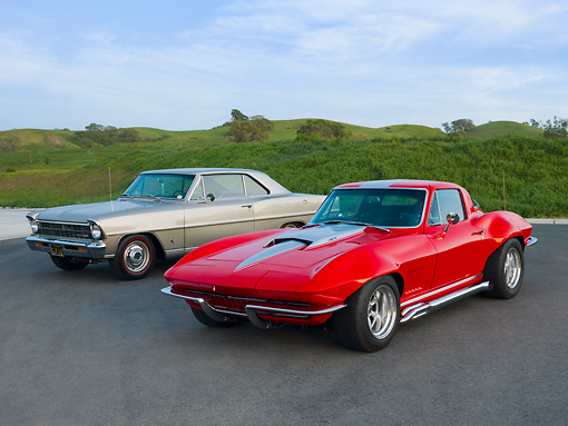 AUT 31 RK0102 01 © Kimball Stock 1967 Chevrolet Nova Beige & 1967 Chevrolet Corvette Red With Silver Stripe 3/4 Front View On Pavement By Hills
