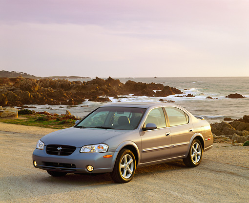 AUT 33 RK0007 02 © Kimball Stock 2000 Nissan Maxima Gray 3/4 Front View On Sand By Ocean Filtered