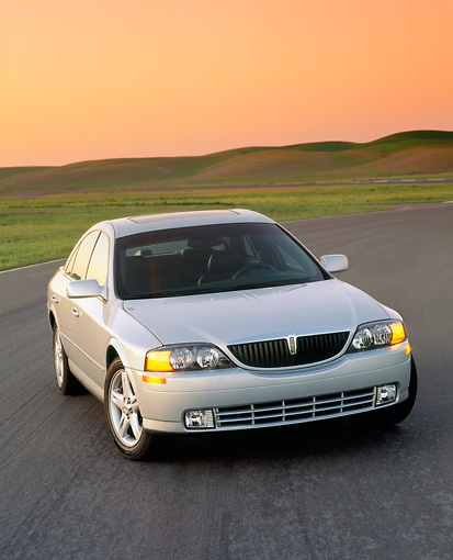 AUT 33 RK0016 02 © Kimball Stock 2000 Lincoln LS Sport Sedan Silver 3/4 Front View On Pavement By Grass Hills Filtered