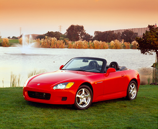 AUT 33 RK0053 01 © Kimball Stock Honda S 2000 Convertible Red Front 3/4 View On Grass By Water Fountain Filtered