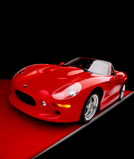 AUT 33 RK0305 19 © Kimball Stock 2000 Shelby Series One Red Convertible Wide Angle 3/4 Front View On Red Floor Gray Line Studio