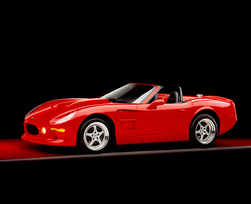 AUT 33 RK0306 01 © Kimball Stock 2000 Shelby Series One Red Convertible 3/4 Side View On Red Floor Gray Line Studio
