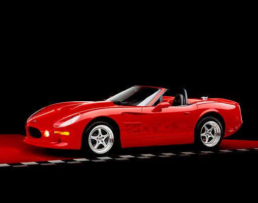 AUT 33 RK0307 04 © Kimball Stock 2000 Shelby Series One Convertible Red 3/4 Side View On Checkered Line Red Floor Studio