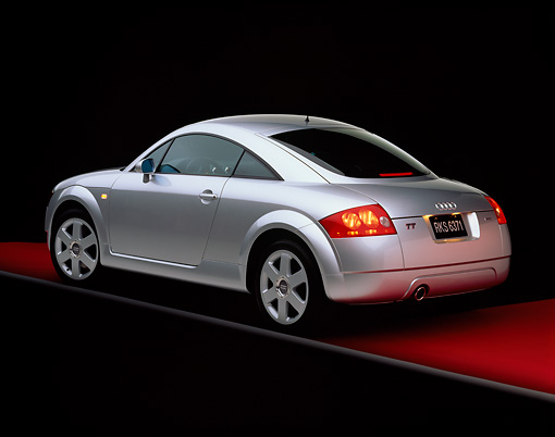 AUT 33 RK0067 01 © Kimball Stock 2000 Audi Quattro TT Coupe Silver 3/4 Rear View On Red Floor Gray Line Studio