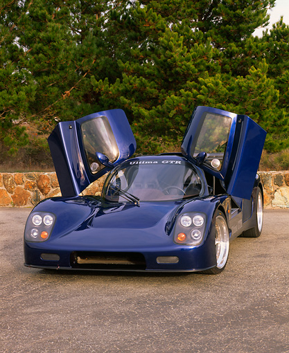 AUT 33 RK0093 02 © Kimball Stock 2000 Ultima GTR Blue 3/4 Front View Doors Open On Pavement By Trees