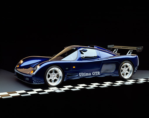 AUT 33 RK0111 02 © Kimball Stock 2000 Ultima GTR Blue 3/4 Side View On Checkered Line Studio