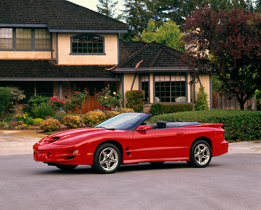AUT 33 RK0150 04 © Kimball Stock 2000 Pontiac Firebird Trans Am WS6 Convertible Red 3/4 Side View By House