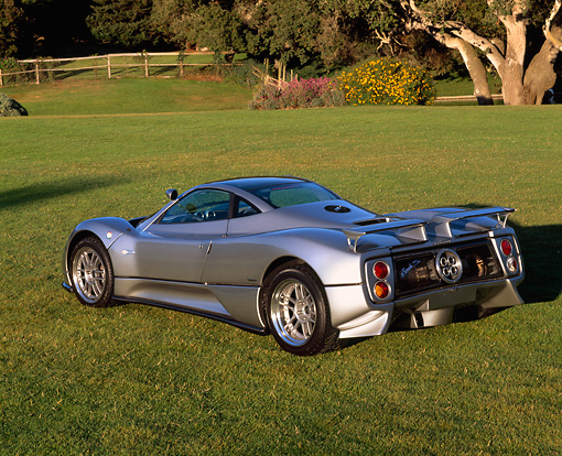 AUT 33 RK0237 02 © Kimball Stock 2000 Zonda C12 S Silver 3/4 Rear View On Grass