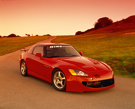 AUT 33 RK0265 02 © Kimball Stock 2000 Honda S2000 Red 3/4 Front View On Pavement By Grass Hills Filtered