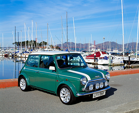 AUT 33 RK0298 03 © Kimball Stock 2000 Cooper Sports Pack Green With White Stripes 3/4 Front View On Pavement By Harbor