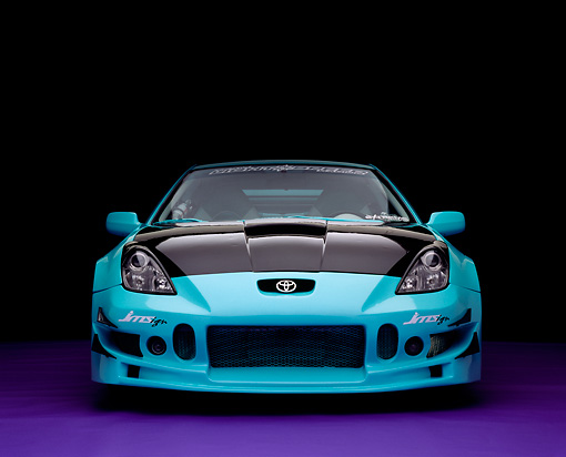 AUT 33 RK0346 01 © Kimball Stock 2000 Toyota Celica Teal Head On Shot On Purple Floor Studio