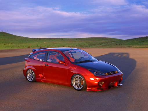 AUT 33 RK0347 01 © Kimball Stock 2000 Ford Focus ZX3 Candy Apple Red 3/4 Side View On Pavement