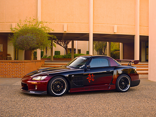 AUT 33 RK0360 01 © Kimball Stock 2000 Honda S2000 Raspberry And Black 3/4 Side View On Pavement
