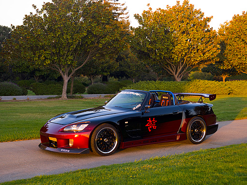 AUT 33 RK0361 01 © Kimball Stock 2000 Honda S2000 Raspberry And Black Low 3/4 Side View On Pavement