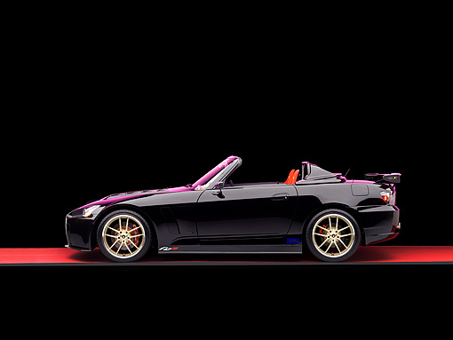 AUT 33 RK0363 01 © Kimball Stock 2000 Honda S2000 Convertible Black Profile View Studio