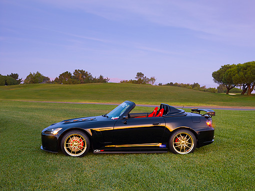 AUT 33 RK0370 01 © Kimball Stock 2000 Honda S2000 Convertible Black Profile View On Grass