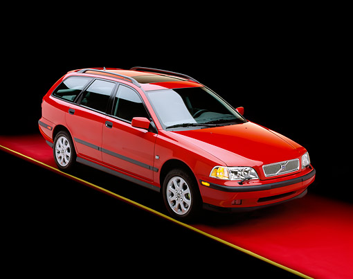 AUT 34 RK0012 01 © Kimball Stock 2001 Volvo V40 Red 3/4 Front View On Red Floor Yellow Line Studio
