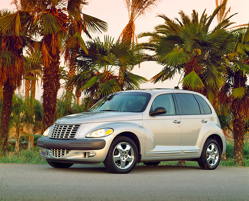 AUT 34 RK0066 09 © Kimball Stock 2001 Chrysler PT Cruiser Silver 3/4 Side View On Pavement By Palm Trees Filtered
