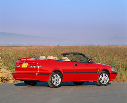 AUT 34 RK0118 03 © Kimball Stock 2001 Saab 93 Convertible Red 3/4 Rear View On Pavement Blue Sky