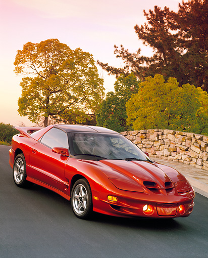 AUT 34 RK0168 02 © Kimball Stock 2001 Pontiac Firebird Trans Am Sunset Orange Slanted Front 3/4 View On Pavement Filtered