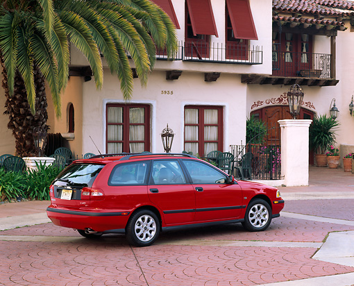 AUT 34 RK0004 04 © Kimball Stock 2001 Volvo V40 Red 3/4 Rear View By Spanish Building