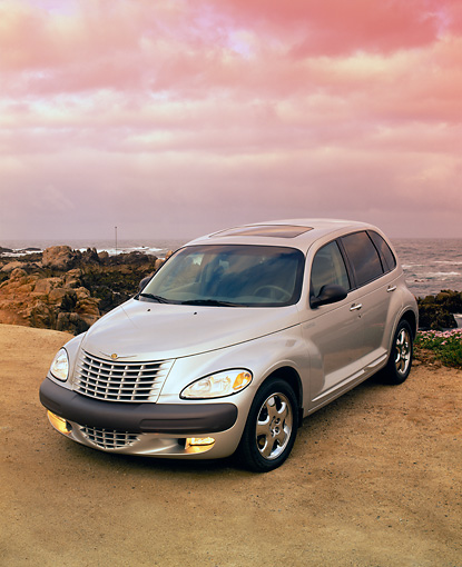 AUT 34 RK0051 02 © Kimball Stock 2001 Chrysler PT Cruiser Silver 3/4 Front View On Sand Hill Filtered
