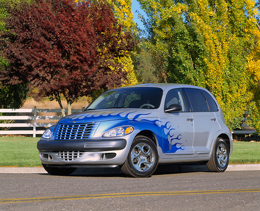 AUT 34 RK0130 01 © Kimball Stock 2001 Chrysler PT Cruiser Silver Blue Flames 3/4 Front View On Pavement