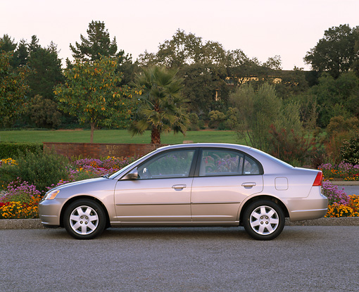 AUT 34 RK0139 02 © Kimball Stock 2001 Honda Civic EX Champagne Profile View On Pavement By Flowers And Trees