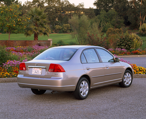 AUT 34 RK0141 03 © Kimball Stock 2001 Honda Civic EX Champagne 3/4 Rear View On Pavement By Flowers And Trees