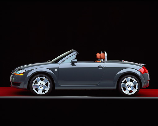 AUT 34 RK0152 09 © Kimball Stock 2001 Audi TT Roadster Gray Profile View On Red Floor Gray Line Studio