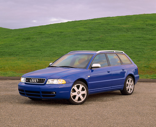 AUT 34 RK0238 01 © Kimball Stock 2001 Audi S4 Avant Blue 3/4 Front View On Pavement By Grass Hills Gray Clouds