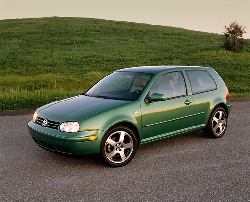 AUT 34 RK0250 03 © Kimball Stock 2001 VW GTI GLS 1.8 T Green Side 3/4 View On Pavement By Grass Hill At Dusk