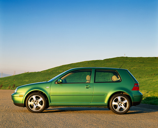 AUT 34 RK0251 01 © Kimball Stock 2001 Volkswagen GTI GLS 1.8 T Green Profile View On Pavement By Grass Hills