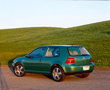 AUT 34 RK0255 01 © Kimball Stock 2001 VW GTI GLS 1.8 T Green Rear 3/4 View On Pavement By Grass Hill At Dusk