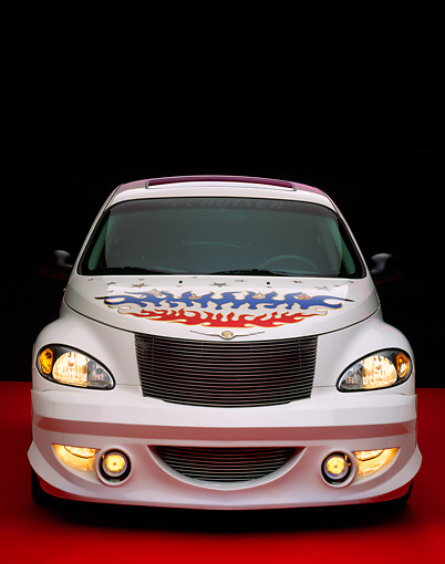 AUT 34 RK0299 03 © Kimball Stock 2001 PT Cruiser White With Flames And Stars Head On Red Floor Studio