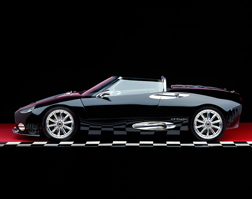 AUT 34 RK0321 05 © Kimball Stock 2001 Spyker C8 Spyder Black Profile View On Checkered Line Red Floor Studio