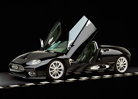 AUT 34 RK0323 14 © Kimball Stock 2001 Spyker C8 Spyder Black Side 3/4 View Doors Open Checkered Line Black Floor Studio