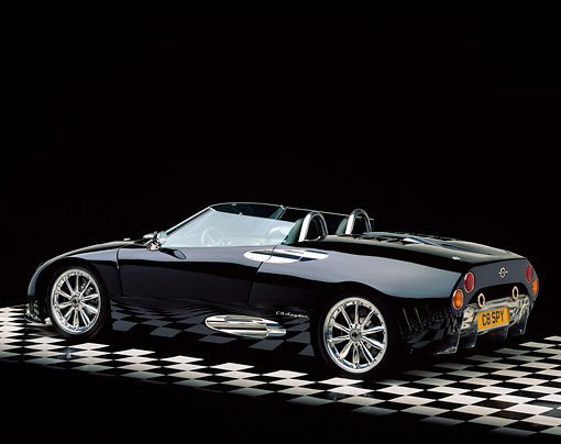AUT 34 RK0324 05 © Kimball Stock 2001 Spyker C8 Spyder Black Rear 3/4 View On Checkered Floor Studio