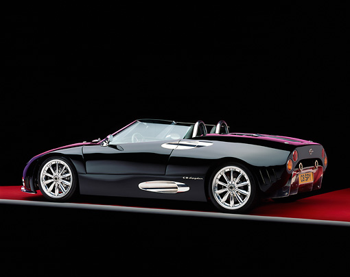 AUT 34 RK0326 11 © Kimball Stock 2001 Spyker C8 Spyder Black Rear 3/4 View On Red Floor Gray Line Studio
