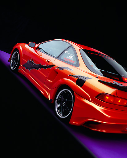 AUT 34 RK0387 02 © Kimball Stock 2001 Acura Integra Orange Slanted 3/4 Rear View Studio