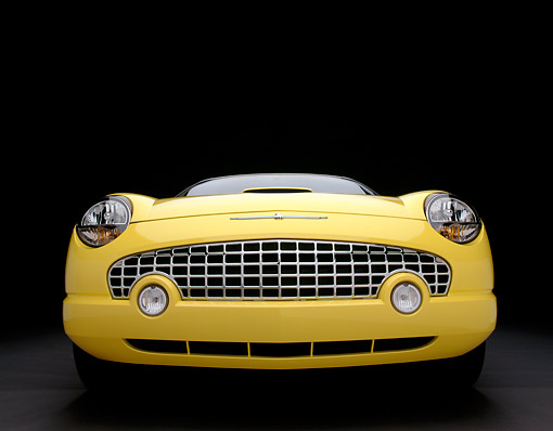 AUT 35 RK0105 15 © Kimball Stock 2002 Ford Thunderbird Convertible Yellow Wide Angle Head On Shot Studio