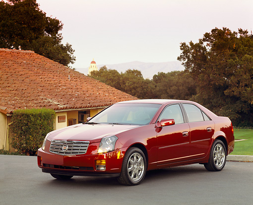 AUT 35 RK0114 01 © Kimball Stock 2002 Cadillac CTS Burgundy Front 3/4 View On Pavement By Trees