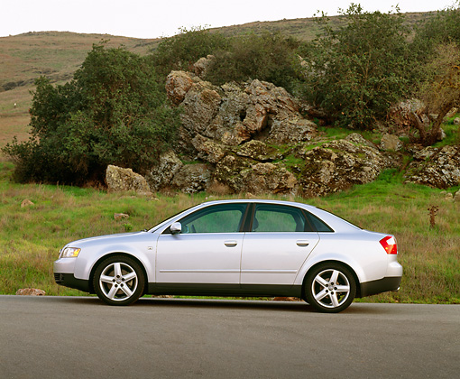 AUT 35 RK0145 01 © Kimball Stock 2002 Audi A4 3.0 Quattro MT6 Silver Profile On Pavement By Rocks And Trees
