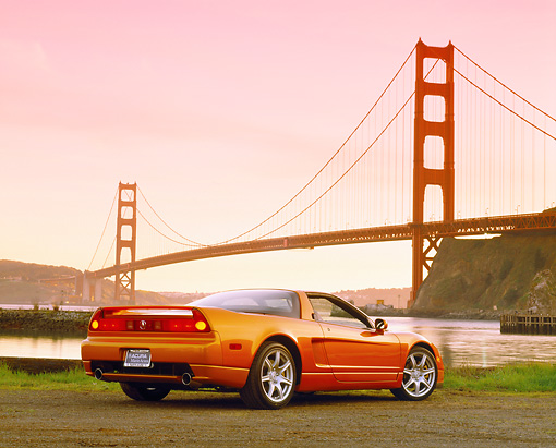 AUT 35 RK0158 04 © Kimball Stock 2002 Acura NSX Imola Orange Low 3/4 Rear View On Pavement By SF Bridge Filtered