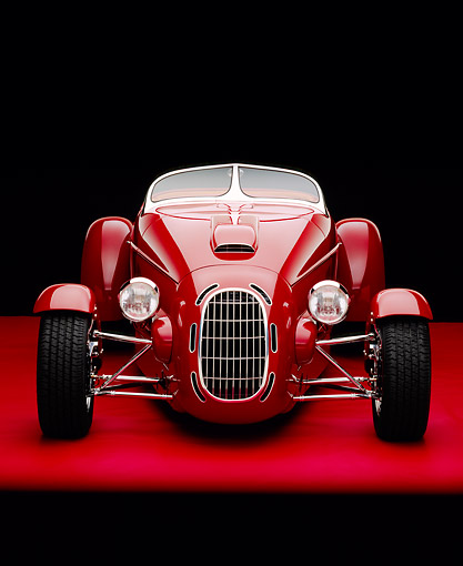 AUT 35 RK0189 07 © Kimball Stock 2002 Torpedo Roadster Red Head On Shot On Red Floor Studio