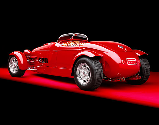 AUT 35 RK0196 01 © Kimball Stock 2002 Torpedo Roadster Custom Red 3/4 Rear View On Red Floor Studio