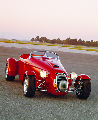 AUT 35 RK0207 09 © Kimball Stock 2002 Torpedo Roadster Custom Red 3/4 Front View On Pavement Filtered