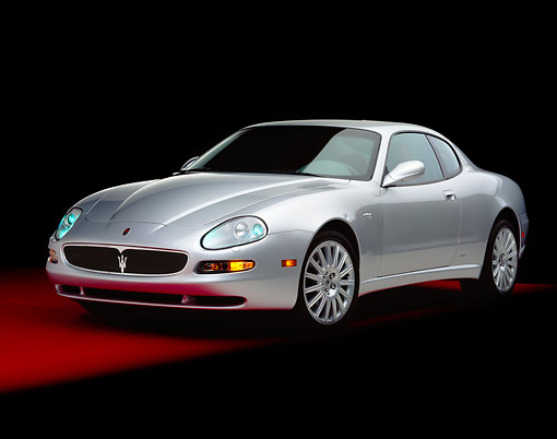 AUT 35 RK0363 11 © Kimball Stock 2002 Maserati GT Coupe Silver 3/4 Front View On Red Floor Studio