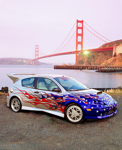 AUT 35 RK0392 01 © Kimball Stock 2002 Ford Focus FR200 Turbo Silver With Graphics 3/4 Side View On Pavement By Golden Gate Bridge